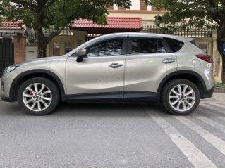 Cần bán lại xe Mazda CX 5 đăng ký lần đầu 2013, màu vàng còn mới, giá tốt 565 triệu đồng