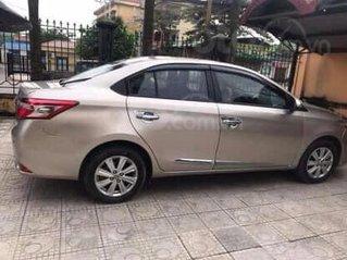 Cần bán ô tô Toyota Vios G số tự động sản xuất 2014, màu vàng cát