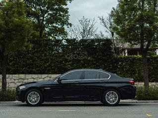 Cần bán BMW 520i sản xuất 2014, màu đen nội thất kem, biển Hà Nội