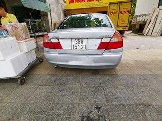 Cần bán gấp Mitsubishi Lancer đời 2002, màu bạc