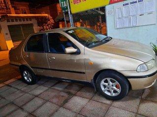 Xe Fiat Siena sản xuất năm 2002, màu vàng, nhập khẩu