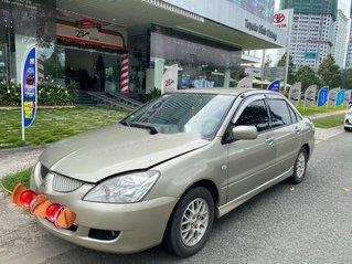 Xe Mitsubishi Lancer đời 2004, màu vàng