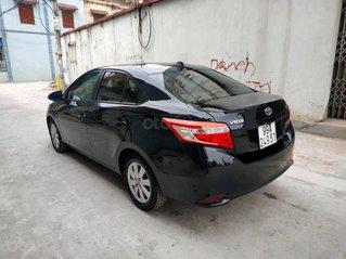 Cần bán Toyota Vios đời 2015, màu đen, số sàn