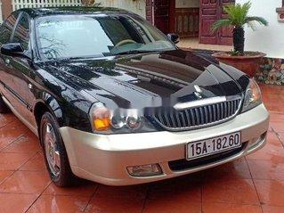 Cần bán lại xe Daewoo Magnus đời 2004, màu đen, 125tr