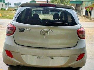 Cần bán Hyundai Grand i10 đời 2014, màu bạc, xe nhập ít sử dụng