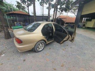 Cần bán lại xe Mazda 323 đời 1999, màu vàng