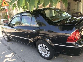 Cần bán xe Ford Laser đời 2004, màu đen, nhập khẩu còn mới, 185tr