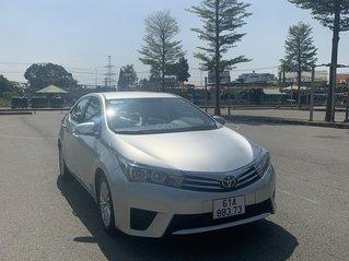 Cần bán xe Toyota Corolla Altis đăng ký 2015, màu Bạc mới 95% giá chỉ 490 triệu đồng