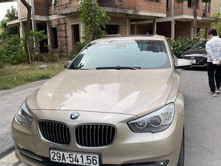 Xe BMW 5 Series 535i GT đời 2012, màu vàng