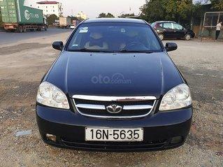 Cần bán lại xe Daewoo Lacetti đời 2010, màu đen