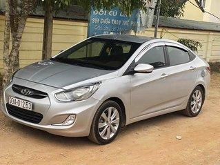 Xe Hyundai Accent 1.4 AT sản xuất năm 2012, màu bạc, xe nhập