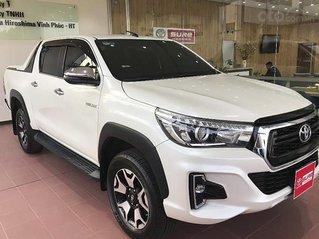 Cần bán Toyota Hilux 2.8G 4x4 AT năm sản xuất 2019, màu trắng