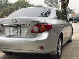 Cần bán lại xe Toyota Corolla 1.6AT đời 2009, màu bạc