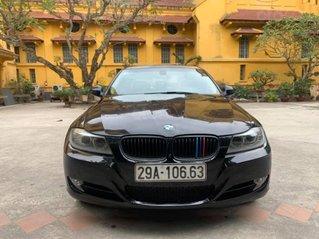 Bán xe BMW 320i sản xuất năm 2010, màu đen, giá đẹp cuối năm