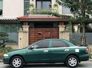 Bán Mazda 323 đời 2004, màu xanh lục