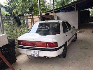 Cần bán gấp Mazda 323 đời 1995, màu trắng, nhập khẩu