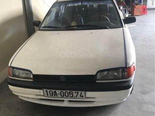 Bán giá thấp xe Mazda 323 năm 1995, màu trắng, nhập khẩu Nhật, xe tập lái quá hợp lý