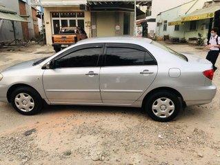 Cần bán Toyota Corolla đời 2002, màu bạc