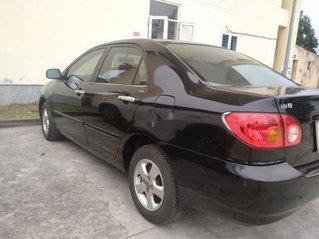Cần bán gấp Toyota Corolla Altis đời 2003, màu đen
