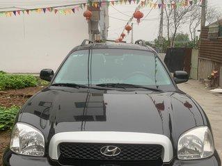 Cần bán xe Hyundai Santa Fe đăng ký lần đầu 2004, màu đen xe gia đình giá chỉ 245 triệu đồng