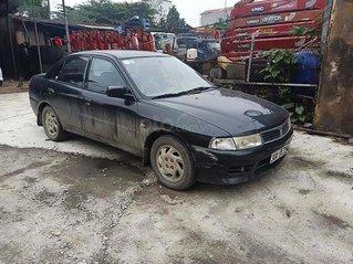 Cần bán gấp Mitsubishi Lancer đời 2001, màu đen