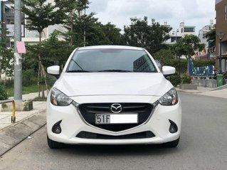 Bán Mazda 2 sản xuất 2015, màu trắng còn mới