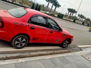 Cần bán gấp Daewoo Lanos sản xuất năm 2002, màu đỏ còn mới