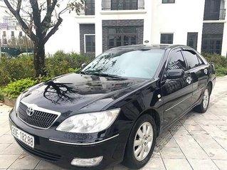 Bán xe Toyota Camry sản xuất năm 2003, màu đen còn mới, 279tr