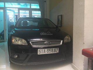 Gia đình cần bán gấp xe Ford Focus 1.8, hãng bán ra 2009 màu đen 205tr