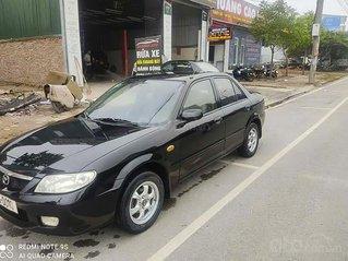 Bán ô tô Mazda 323 năm 2003, màu đen chính chủ, giá tốt