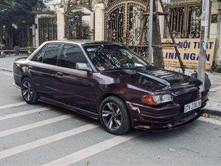 Cần bán xe Mazda 323 sản xuất năm 1997, màu đỏ, xe nhập