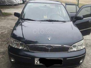 Bán Ford Laser năm sản xuất 2002, màu đen, xe nhập còn mới giá cạnh tranh
