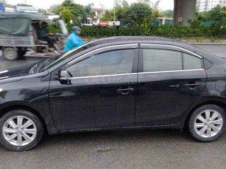 Cần bán gấp Toyota Vios MT đời 2015, màu đen số sàn