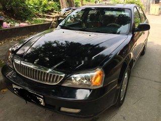 Cần bán Daewoo Magnus đời 2004, màu đen còn mới, giá 108tr