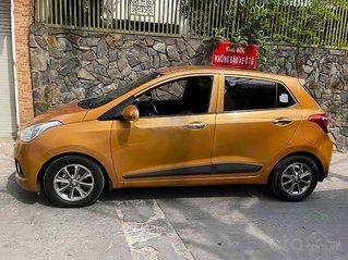 Cần bán xe Hyundai Grand i10 1.0 AT năm 2014, màu vàng, nhập khẩu nguyên chiếc, giá chỉ 288 triệu