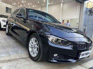 Cần bán lại xe BMW 320i năm 2013, màu đen, nhập khẩu nguyên chiếc còn mới, giá chỉ 720 triệu