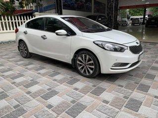 Bán xe Kia K3 1.6 đời 2014, màu trắng, giá chỉ 442 triệu