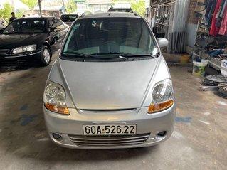 Cần bán gấp Chevrolet Spark LT đời 2009, màu bạc