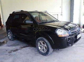 Cần bán xe Hyundai Tucson 2.0 sản xuất 2009, màu đen, nhập khẩu nguyên chiếc còn mới