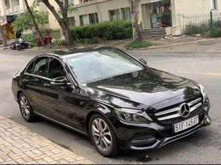 Bán Mercedes C200 2015, màu đen, giá 950tr