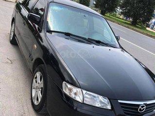 Cần bán Mazda 626 sản xuất năm 2000, màu đen, nhập khẩu