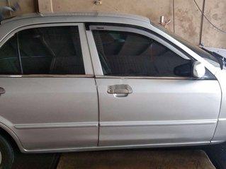 Cần bán xe Mazda 323 đời 2001, màu bạc, xe nhập