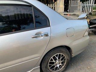 Cần bán xe Mitsubishi Lancer sản xuất năm 2004, màu bạc chính chủ, 180tr