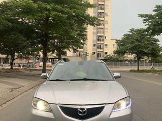 Cần bán Mazda 3 AT đời 2004, màu ghi vàng số tự động