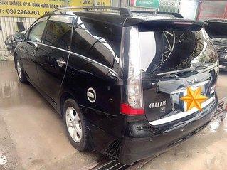 Cần bán xe Mitsubishi Grandis đời 2007, màu đen xe gia đình