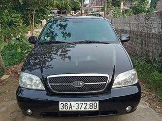 Cần bán lại xe Kia Carnival sản xuất năm 2009, màu đen số tự động