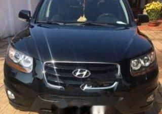 Bán xe Hyundai Santa Fe SLX sản xuất 2009, màu đen xe gia đình