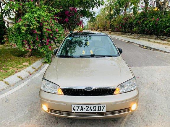 Cần bán lại xe Ford Laser sản xuất năm 2002, màu vàng
