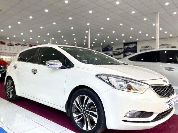 Bán xe Kia Cerato năm 2014, màu trắng, nhập khẩu nguyên chiếc còn mới, giá 458tr