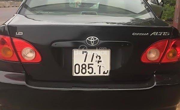 Cần bán Toyota Corolla altis 1.8G MT đời 2001, màu đen chính chủ, 190 triệu